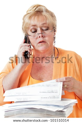 Mature woman calling to discuss healthcare benefit paperwork