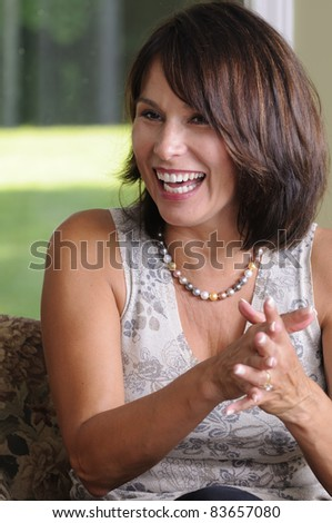 Mature Woman Caught Laughing At A Party