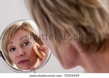 Mature Woman Cleaning Face
