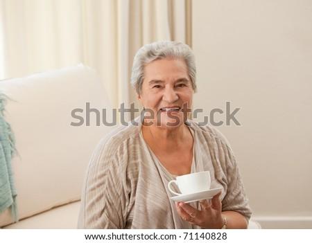 Mature woman drinking some tea