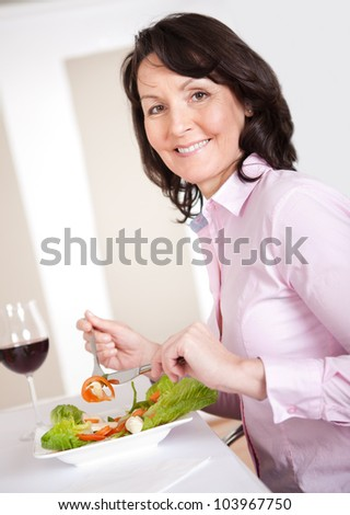 Mature woman having lunch together at home
