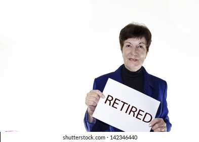 Stock photo of mature woman holding retired sign