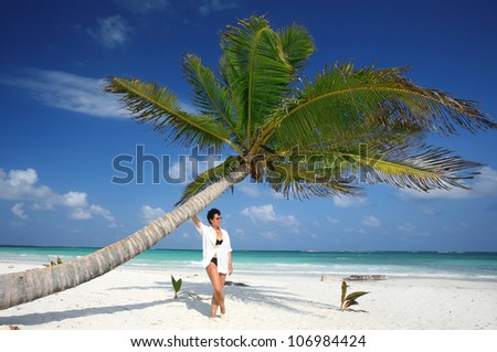 mature woman in a relaxed holiday atmosphere at a tropical white sand beach, Mexiko-Yucatan