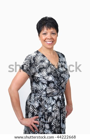 mature woman in black and white dress isolated on white