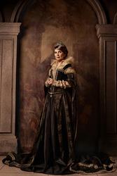 Mature woman in elegant costume of queen
