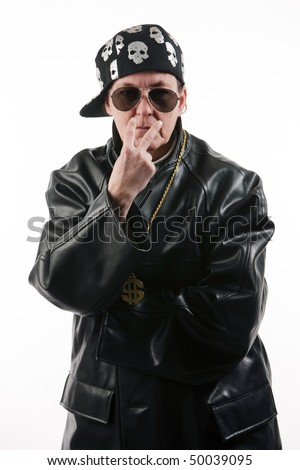 stock photo : Mature woman in the role of a tough rapper wearing leather, ...