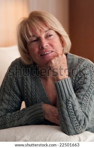 mature woman laughing. Indoor location.
