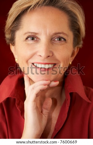 Mature woman looks straight at the camera.