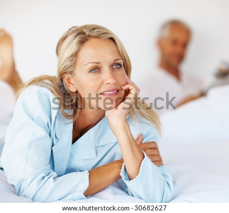 stock photo : Mature woman lying on the bed day dreaming with husband at the ...