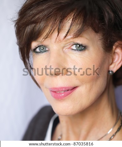 stock photo : Mature woman portrait with short hair. Save to a lightbox ▼