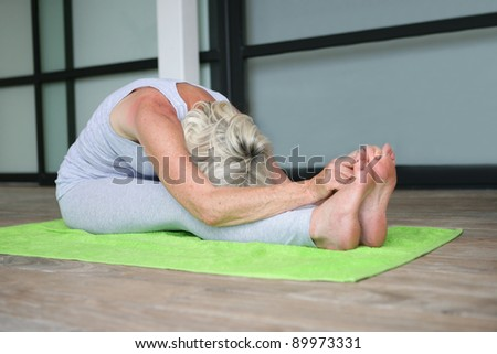 Mature woman practicing yoga