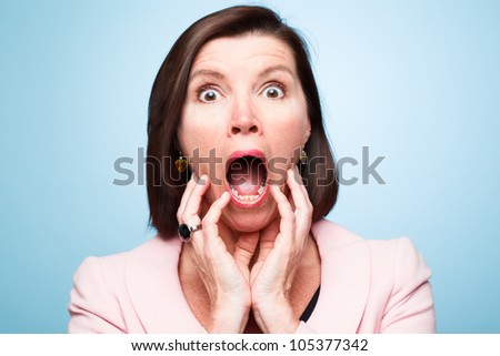 mature woman pulling funny faces