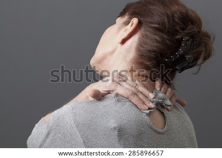mature woman relaxing pain and pressure in neck and shoulders