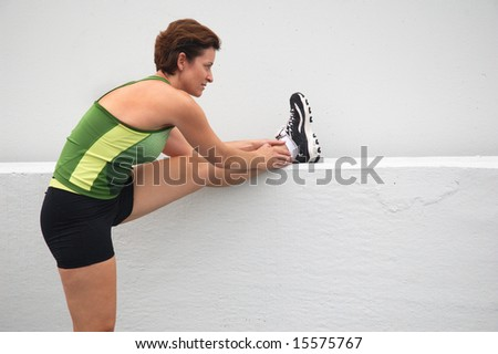 Mature woman runner in the city.