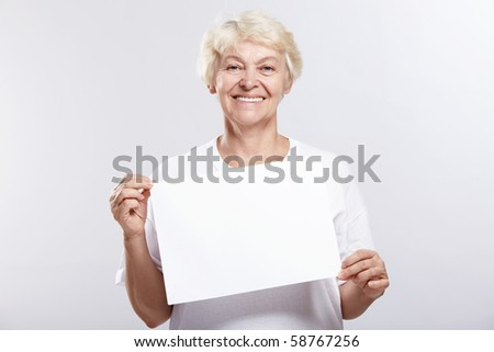 Mature woman smiling with an empty plate on a white background