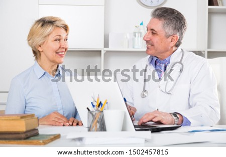 Mature woman visits doctor for survey of condition of health #1502457815