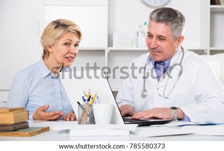 Mature woman visits doctor for survey of condition of health #785580373