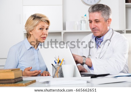 Mature woman visits doctor in hospital for survey and check of your health #665662651