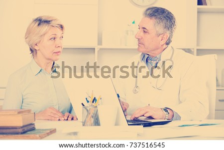 Mature woman visits doctor in hospital for survey and check of your health #737516545