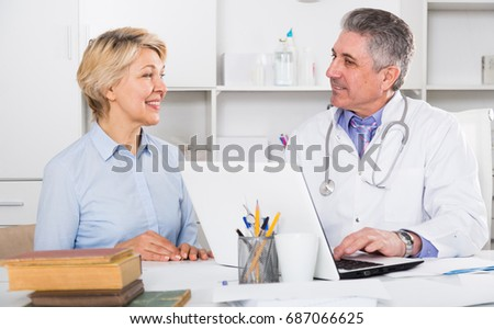 Mature woman visits doctor to medical office for planned inspection of health #687066625