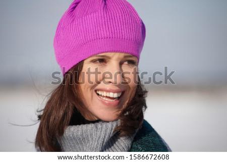 Mature woman wearing pink winter hat