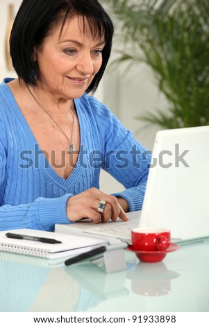 Mature woman with a laptop