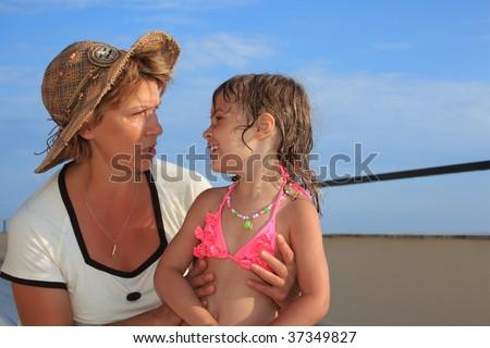 stock photo : mature woman with little girl on veranda