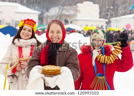Mature woman with pancakes during  Shrovetide at Russia