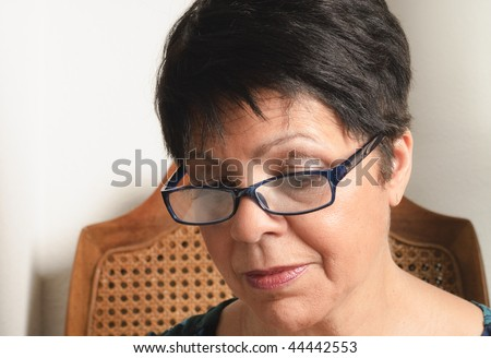 stock photo : mature woman with short hair and glasses