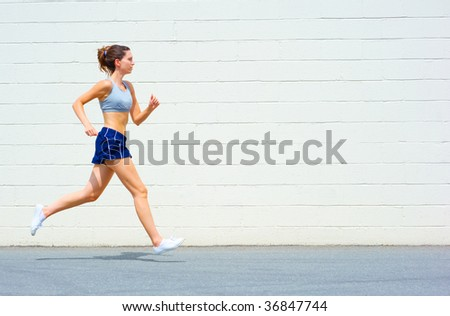 Mature woman working out in an urban setting, from a complete set of photos.