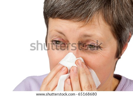 Mature Women Using Tissue to Blow or Wipe Nose