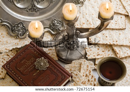 Matza bread for passover celebration with  torah and red wine