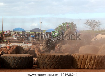 MAUI, HAWAII-DEC 9: Rock crawler vehicle driver Phil Hooper fights the dust as he takes second place at Maui Motorsports Park on December 9, 2012 in Maui, Hawaii.