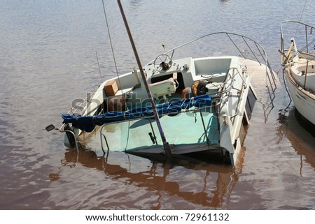 MAUI, HAWAII-MAR 11: Tsunami from a Japanese earthquake causes severe damage to a small craft in Maalea Harbor on March 11, 2011 in Maui, Hawaii.
