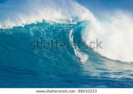 "MAUI, HI - MARCH 13: Professional surfer Billy Kemper rides a giant wave at the legendary big wave surf break known as ""Jaws"" during one the largest swells of the winter March 13, 2011 in Maui, HI."