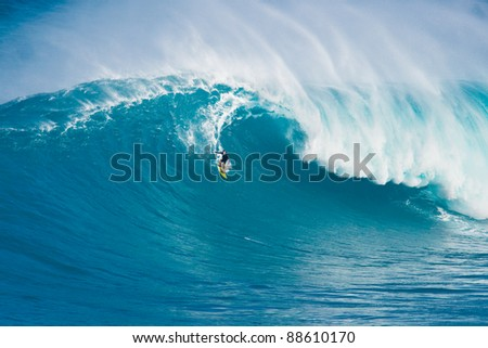 "MAUI, HI - MARCH 13: Professional surfer Carlos Burle rides a giant wave at the legendary big wave surf break known as ""Jaws"" during one the largest swells of the winter March 13, 2011 in Maui, HI."