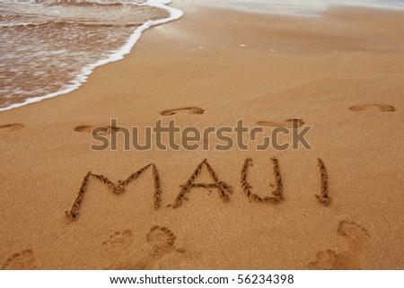 maui written in the sand on the hawaiian beach