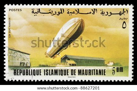 MAURITANIA - CIRCA 1976: A stamp printed in Mauritania shows a Zeppelin LZ74 airship, circa 1976