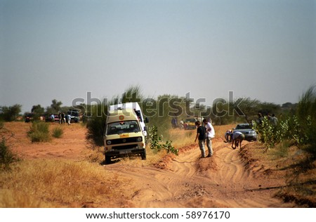 MAURITANIA - JANUARY 7: Participants of Budapest - Bamako Rally are crossing the savannah  on January 7, 2006, Mauritania. The Rally is very popular among the young. - stock photo