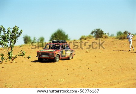 MAURITANIA - JANUARY 7: Participants of Budapest - Bamako Rally cross the savannah  on January 7, 2006, Mauritania. The Rally is going through the Sahara as well.