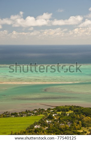 Mauritius: beach, clear waters and dramatic sky