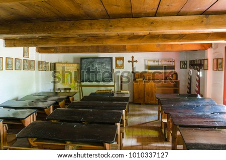 Maurzyce/Poland - June 15, 2015. Interior of a classroom located in the wooden cottage in the open-air museum in Maurzyce, Poland #1010337127