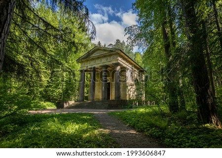Mausoleum with the inscription 'To the Spouse of the benefactor' in the forest in Pavlovsk Park in the summer Stock photo ©