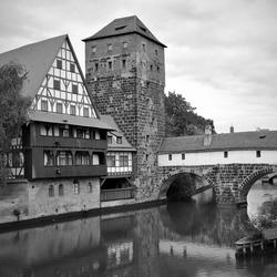 Maxbrucke bridge over Pegnitz river in Nuremberg, Germany. Black and white photography, german landscape