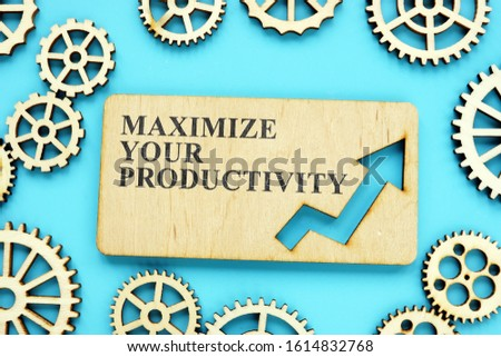 Maximize Your Productivity phrase on the wooden plate and gears.
