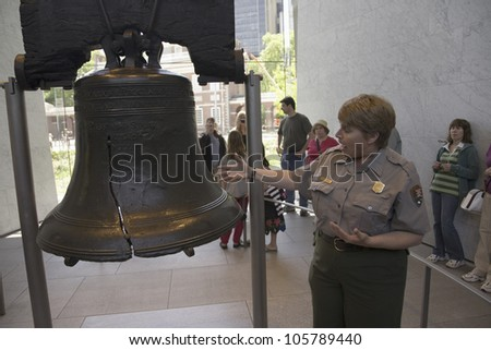 MAY 2007 - A National Park Ranger explaining the crack in the Liberty Bell in Liberty Bell Center, Philadelphia, Pennsylvania