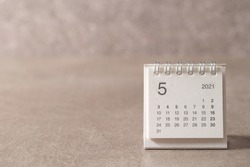 May 2021 calendar on gray background
