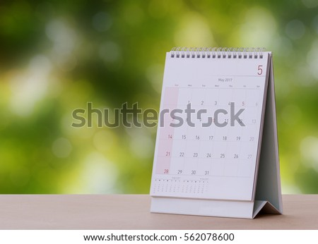 May Calendar 2017 on wood table with Beautiful Nature Bokeh.Blurred background #562078600