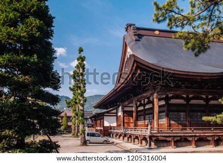 MAY 26, 2013 Gifu, JAPAN - Old historic ancient wooden main hall Honko-Ji temple  of Hida Furukawa old town.  Under Evening light and blue sky #1205316004