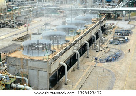 May 2019 in Rayong Thailand. cooling tower and cooling fan blowing steam on the air in chemical plant,  refinery plant, oil and gas plant during operation.